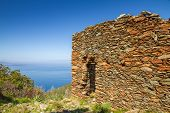 pic of iron ore  - An old stone ruined building at the site of a 16th century iron ore mine near Farinole on Cap Corse in Corsica - JPG