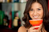 Woman Drinking Cocktails At A Bar