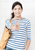 education concept - lovely teenage girl showing v-sign