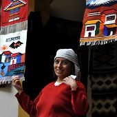 Indian Women Sells The Products Of Her Weaving