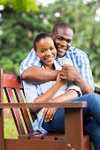 beautiful young african american couple sitting at the park