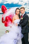 Beautiful Bride With Groom On Seashore