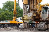 stock photo of foundation  - building house foundations with bore pile machine - JPG