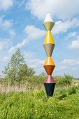 Colorful Pole In A Dutch Rural Landscape