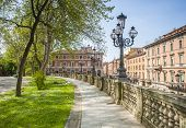 picture of public housing  - Colourful rendered buildings overlooking the public park of Montagnola situtaed in the Italian city of Bologna - JPG