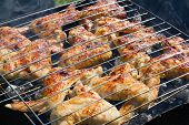 Grilling chicken on a barbecue