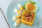 picture of crispy rice  - thai curry fried rice with crispy fish and boiled eggs - JPG