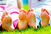 child's foot on the grass