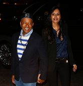 NEW YORK-APR 24: Russell Simmons (L) and guest attend the screening of