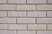 Wall Of White Bricks With Yellow Fugue