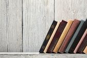 foto of spines  - old book shelf blank spines empty binding stand on wood texture background knowledge concept - JPG