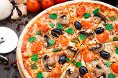 stock photo of diners  - Vegetarian pizza with cherry tomatoes mushroom and olives - JPG