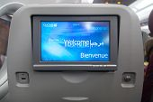 DOHA, QATAR - FEBRUARY 18, 2014: Economy class seat with entertainment system onboard. Qatar Airways