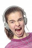 Keen  Shouting Female Teenager With Headphones, Isolated On White