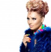 Beauty Woman Portrait in fashion blue fur coat, with Colorful Makeup, Nail polish and Accessories. C