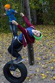 Two Boys On Swings