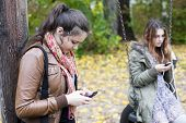 Two Girls With Phones