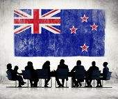Silhouettes of Business People and a Flag of New Zealand