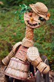 stock photo of scarecrow  - Creative straw scarecrow in a countryside garden - JPG