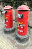 DELHI, INDIA - November 30, 2012: Two red postboxes outside the India post office