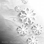 eps10 vector snowflakes on crumpled paper Christmas concept background
