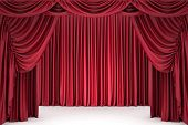Open red theater curtain, lit by a spotlight