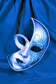 image of incognito  - Festive carnival mask on the background of blue fabric - JPG