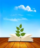 Green tree growing from open book.
