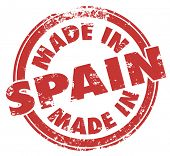 Made in Spain words in a round red stamp to illustrate pride in manufacturing and production in products from the country in Europe