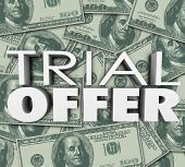 Trial Offer 3d words and letters on a background of money to illustrate a limited time savings discount program