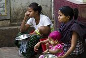 Asking Charity Outside The Burmese Monastery