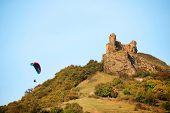 Paraglider flying over the hills