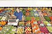 Greengrocer At Work