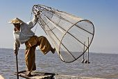 Fisherman/equilibrist On Inle Lake. The Fishermen On Inle Lake (burma, Myanmar) Have Mastered The Ar