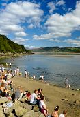 Families enjoy the beach at Portmeirion