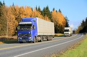 Three Trucks Platooning On A Highway In Autumn