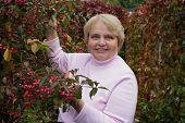 Portrait of a elderly woman in garden