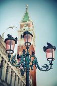 Bell tower and street lamp on St. Mark's Square, Venice