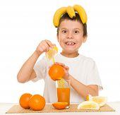 boy drink orange juice with a straw