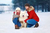 Beautiful Happy Family, Mother And Son Walking With White Samoyed Dog