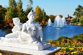 Novi Petrivtsi, Ukraine - October 14: The Statue And Pond With Fishes Are Near