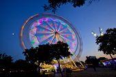 Ferris Wheel in motion during  Fair.