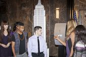 NEW YORK-OCT 16, 2014: Laverne Cox, actress in 'Orange Is The New Black' flips the switch with cast members from her documentary 'The T Word' at the ceremony to light the Empire State Building purple.