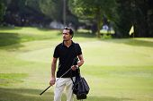 Success attractive man playing golf at leisure on holidays