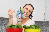 Woman with a spinach in a modern kitchen