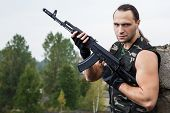 picture of thug  - Army soldier with a gun - JPG
