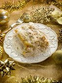 cannelloni over golden christmas table