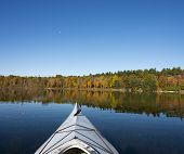 Kayaking On A Northern Lake In Autumn
