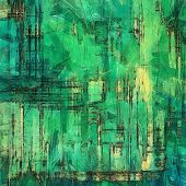 Old designed texture as abstract grunge background. With yellow, green, blue patterns