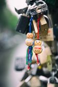 Love locks in the rain with traditional wooden symbols of Amsterdam, filtered to look like an Instag